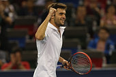 Gilles Simon of France reacts after winning his semi final match against Feliciano Lopez of Spain during the day 7 of the Shanghai Rolex Masters at...