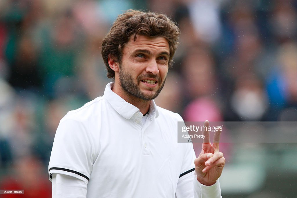 <a gi-track='captionPersonalityLinkClicked' href=/galleries/search?phrase=Gilles+Simon&family=editorial&specificpeople=548968 ng-click='$event.stopPropagation()'>Gilles Simon</a> of France reacts during the Men's Singles second round match against Grigor Dimitrov of Bulgaria on day three of the Wimbledon Lawn Tennis Championships at the All England Lawn Tennis and Croquet Club on June 29, 2016 in London, England.