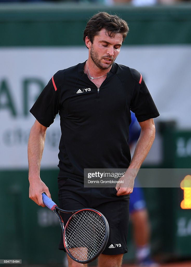 <a gi-track='captionPersonalityLinkClicked' href=/galleries/search?phrase=Gilles+Simon&family=editorial&specificpeople=548968 ng-click='$event.stopPropagation()'>Gilles Simon</a> of France reacts during the Men's Singles third round match against Viktor Troicki of Serbia on day six of the 2016 French Open at Roland Garros on May 27, 2016 in Paris, France.