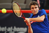 Gilles Simon of France returns a backhand during his semi final match against Mikhail Youzhny of Russia during the betathome German Open Tennis...
