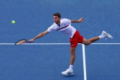 Gilles Simon of France returns a shot against Juan Martin Del Potro of Argentina during Day Seven of the 2011 US Open at the USTA Billie Jean King...
