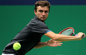 Gilles Simon of France returns a shot during his match against Tomas Berdych of the Czech Republic during the day 6 of the Shanghai Rolex Masters at...
