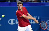 Gilles Simon of France returns a shot from Aljaz Bedene of Great Britain during the second day of the WinstonSalem Open at Wake Forest University on...