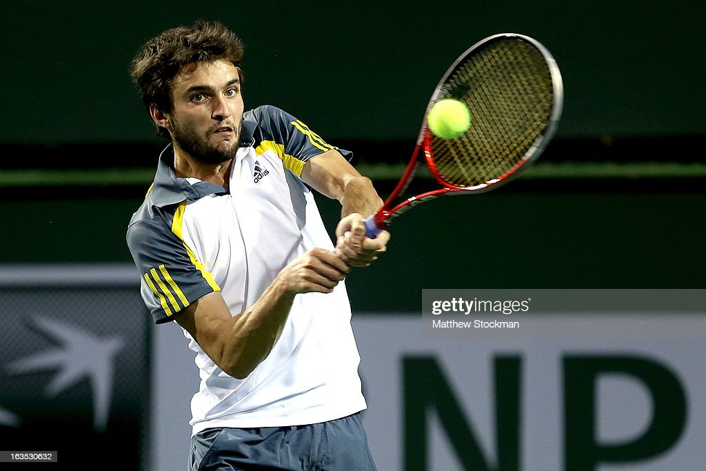 Gilles Simon of France returns a shot to Benoit Paire of France during the BNP Paribas Open at the Indian Wells Tennis Garden on March 11, 2013 in Indian Wells, California.