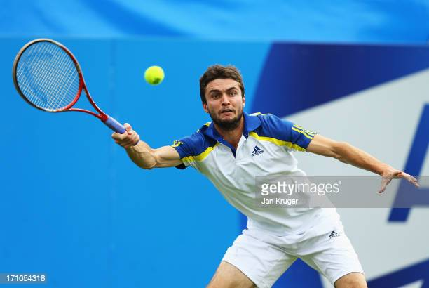 Gilles Simon of France returns in his men's singles semi final match against Andreas Seppi of Italy during day seven of the AEGON International...