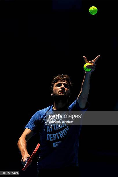 Gilles Simon of France serves during a practice session ahead of the 2015 Australian Open at Melbourne Park on January 16 2015 in Melbourne Australia