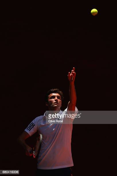 Gilles Simon of France serves during his match against Gael Monfils of France on day three of the Mutua Madrid Open tennis at La Caja Magica on May 8...