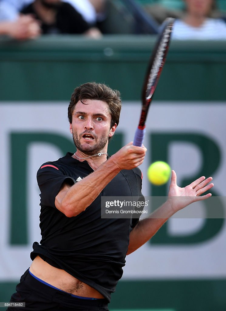 <a gi-track='captionPersonalityLinkClicked' href=/galleries/search?phrase=Gilles+Simon&family=editorial&specificpeople=548968 ng-click='$event.stopPropagation()'>Gilles Simon</a> of France serves during the Men's Singles third round match against Viktor Troicki of Serbia on day six of the 2016 French Open at Roland Garros on May 27, 2016 in Paris, France.