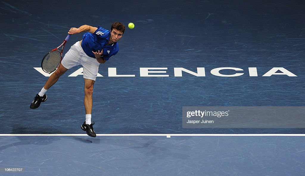 Gilles Simon of France serves the ball to Sergiy Stakhovsky of Ukraine in his first round match during the ATP 500 World Tour Valencia Open tennis tournament at the Ciudad de las Artes y las Ciencias on November 1, 2010 in Valencia, Spain.