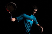 Gilles Simon of France warms up prior to his match against Tomas Berdych of Czech Republic in the Quarter Finals on day 5 of the BNP Paribas Masters...