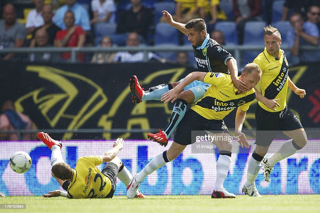 Gilles Swerts of NAC Breda, Ninos Gouriye of ADO Den Haag, Henrico Drost of NAC Breda, Jordy Buijs of NAC Breda during the Dutch Eredivisie match between NAC Breda and ADO Den Haag on August 18, 2013 at the Rat Verlegh stadium in Breda, The Netherlands.