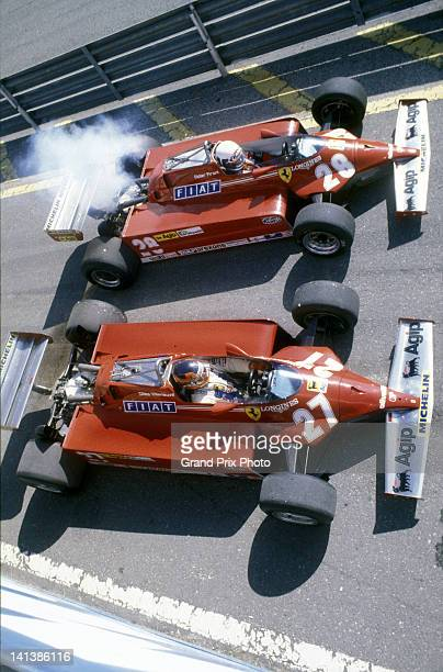 Gilles Villeneuve and Didier Pironi side by side in the pit lane aboard their Scuderia Ferrari 126CK Ferrari V6s before the start of the San Marino...