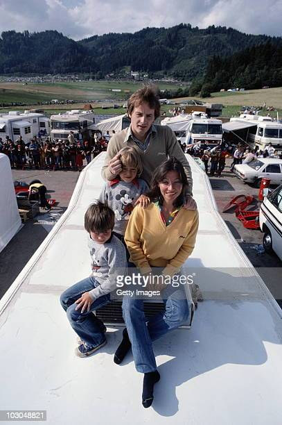 Gilles Villeneuve driver of the Scuderia Ferrari SpA SEFAC Ferrari 312T4 with his wife Joanne and his two children Jacques and Melanie during...