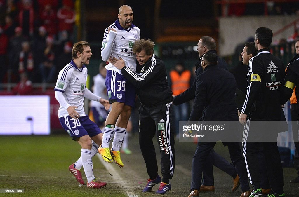 Gillet Guillaume of Rsc Anderlecht - Anthony Vanden Borre of Rsc Anderlecht - John van den Brom head coach of Rsc Anderlecht during the Jupiler League match between Standard Liege and RSC Anderlecht on December 22, 2013 in Liege, Belgium.
