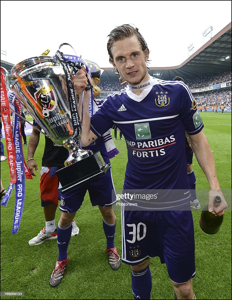 Gillet Guillaume of Rsc Anderlecht celebrates winning the Jupiler League title 2012 - 2013 for the 32nd time in the history of the club on May 19, 2013 in Anderlecht, Belgium.