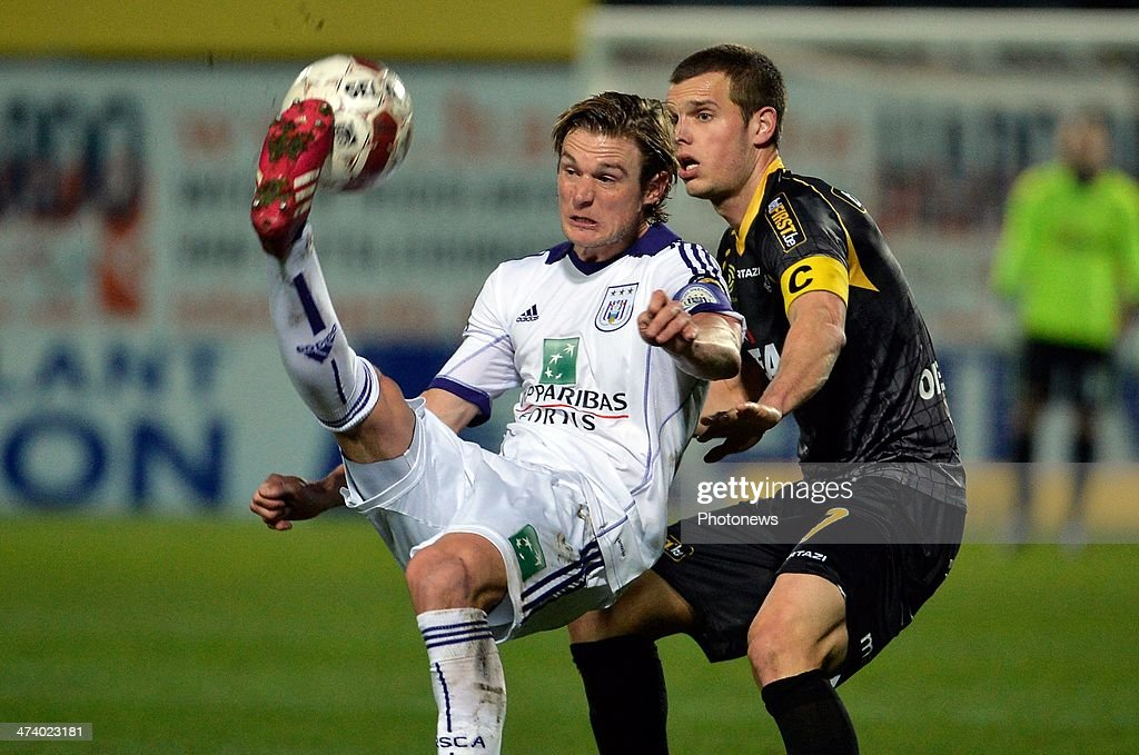 Gillet Guillaume (L) of RSC Anderlecht vies with Killian Overmeire of Sporting Lokeren during the Jupiler League match between Sporting Club Lokeren Oost-Vlaanderen and RSC Anderlecht on February 21, 2014 in Lokeren, Belgium.