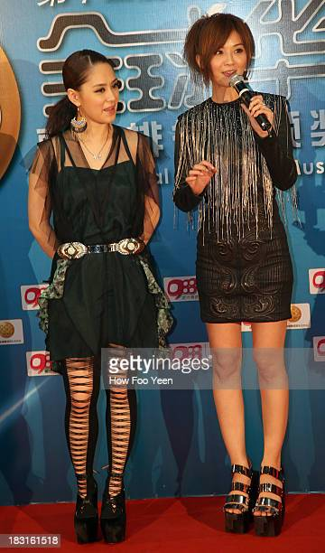 Gillian and Charlene Choi of Hong Kong during the red capet prior to the start of the 13th Global Chinese Music Awards at Putra Stadium on October 5...