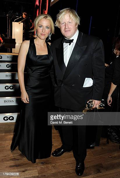 Gillian Anderson and award winner Boris Johnson attend the GQ Men of the Year awards at The Royal Opera House on September 3 2013 in London England