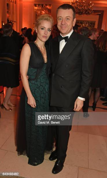 Gillian Anderson and Peter Morgan attend the annual BFI Chairman's Dinner honouring Peter Morgan with the BFI Fellowship at Claridge's Hotel on...