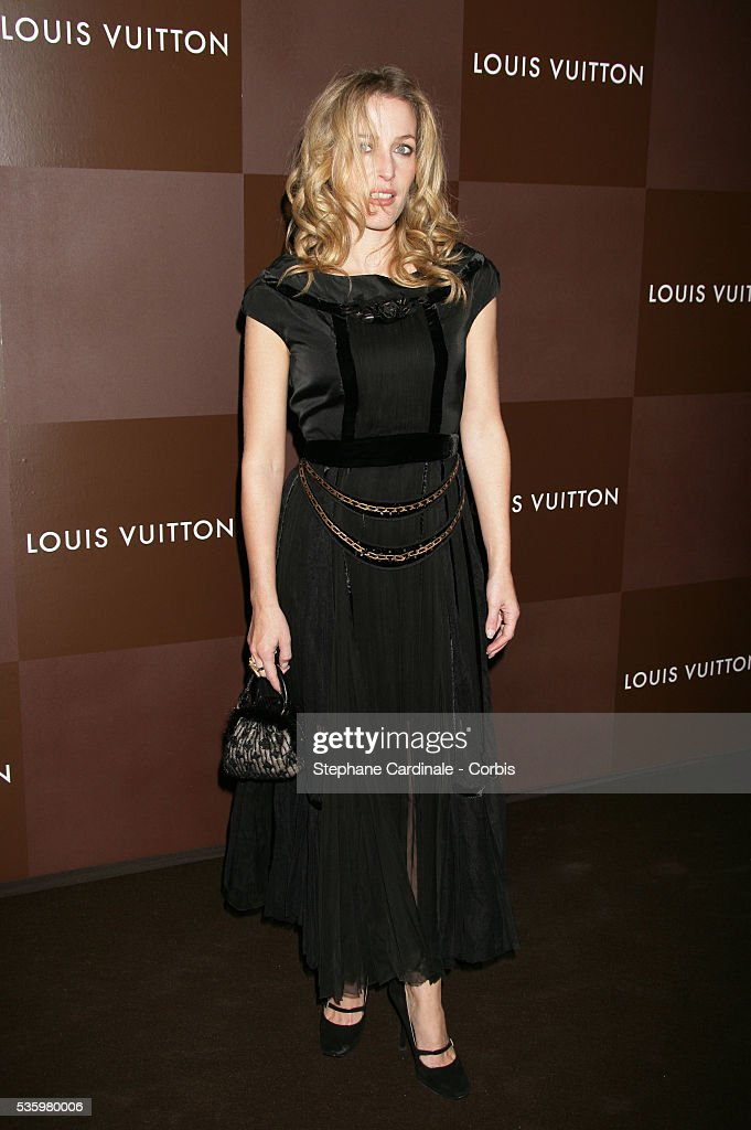 Gillian Anderson arrives at the opening of the new and biggest Louis Vuitton shop in the world on the Champs Elysees, Paris.