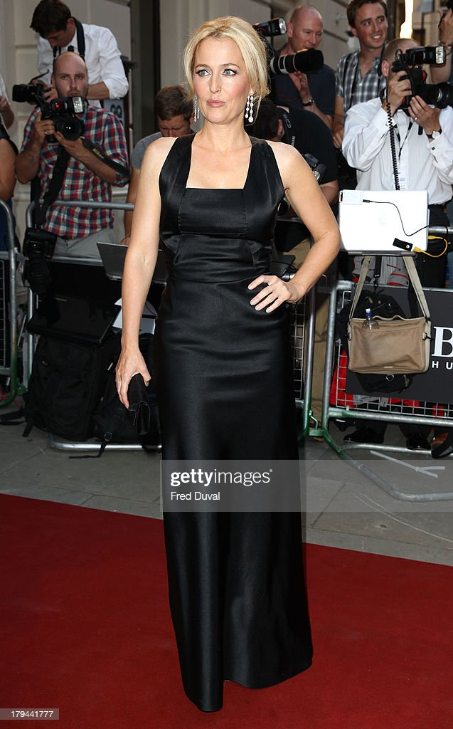 <a gi-track='captionPersonalityLinkClicked' href=/galleries/search?phrase=Gillian+Anderson&family=editorial&specificpeople=202894 ng-click='$event.stopPropagation()'>Gillian Anderson</a> attends the GQ Men of the Year awards at The Royal Opera House on September 3, 2013 in London, England.