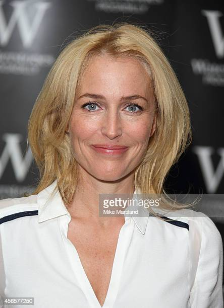 Gillian Anderson meets fans and signs copies of her first novel 'Vision Of Fire' at Waterstone's Piccadilly on October 3 2014 in London England