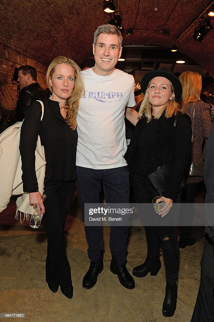 Gillian Anderson, Nick Bloor and Piper Klotz attend the Global Triumph Bonneville launch on October 28, 2015 in London, England.