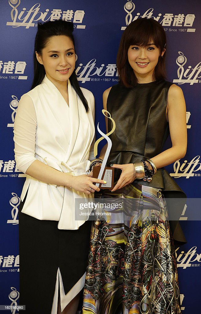 Gillian Chung and Charlene Choi of 'Twins' at the 2013 IFPI Hong Kong Top Sales Music Awards at Star Hall on February 26, 2013 in Hong Kong, Hong Kong.