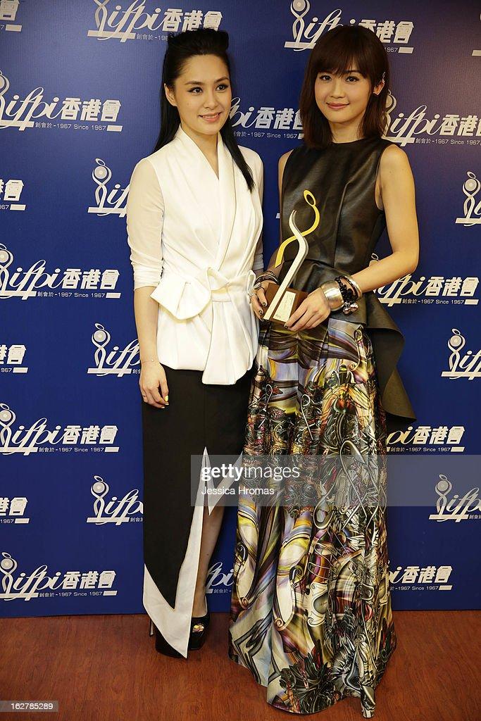 Gillian Chung and Charlene Choi of 'Twins' at the 2013 IFPI Hong Kong Top Sales Music Awards at Star Hall on February 26, 2013 in Hong Kong, Hong Kong.