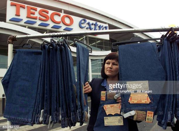 Gillian Laws a Tesco shop assistant with Levi's jeans at the Kingston Park Tesco store in Newcastle The supermarket chain lost its fight to sell...