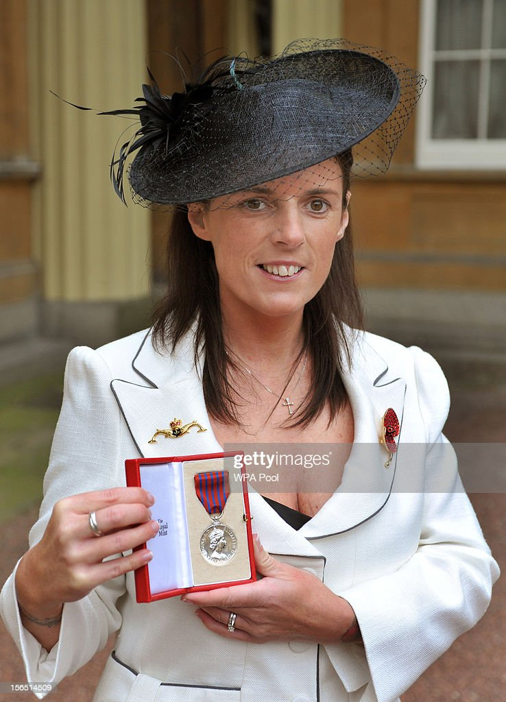 Gillian Molyneux proudly holds the George Medal awarded to her late husband Lt Commander Ian Molyneux Royal Navy, after it was presented to her by Queen Elizabeth II, at the Investiture ceremony at Buckingham Palace on November 16, 2012 in London, England.