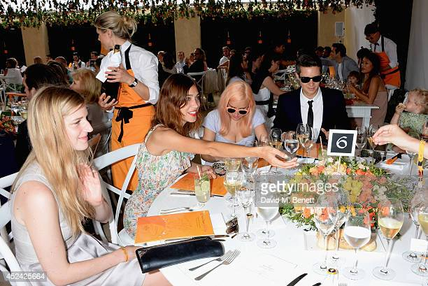 Gillian Orr Alexa Chung and Liz Matthews attend the Veuve Clicquot Gold Cup Final at Cowdray Park Polo Club on July 20 2014 in Midhurst England