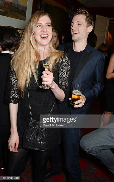 Gillian Orr and George Barnett attend the Esquire Jimmy Choo party the official launch party of London Collections Men AW15 at Marks Club on January...