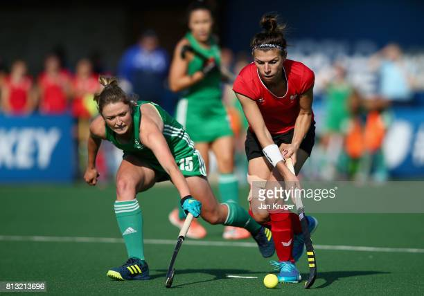 Gillian Pinder of Ireland and Natalia Wisniewska of Poland battle for possession during day 3 of the FIH Hockey World League Semi Finals Pool A match...