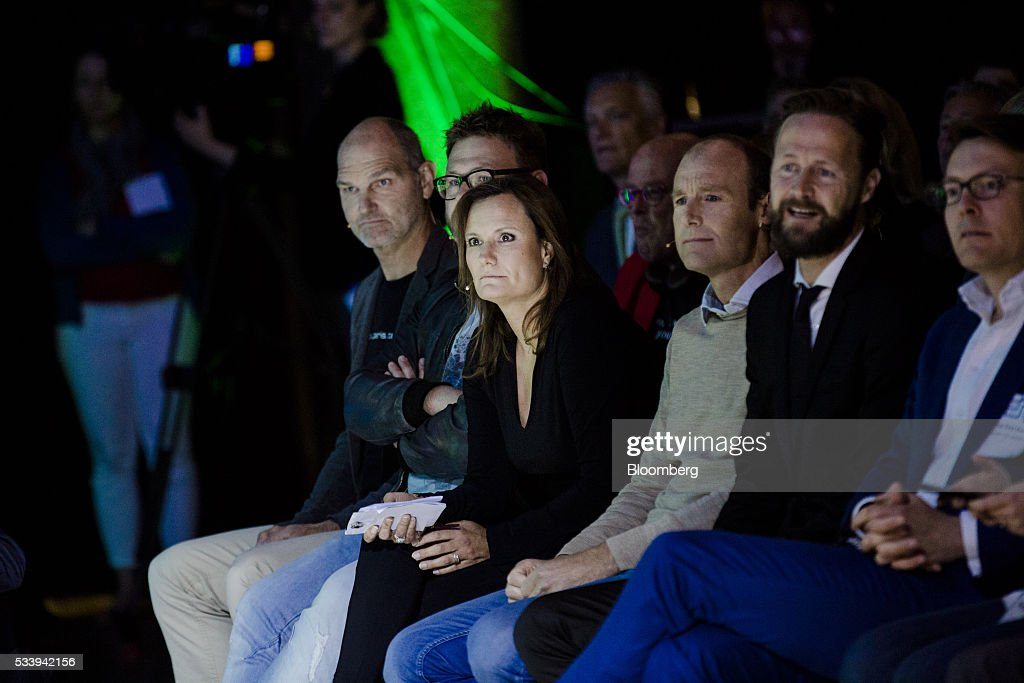 Gillian Tans, chief executive officer of Booking.com, center, sits in the audience during the opening of 'Startup Fest', a five-day conference to showcase Dutch innovation, in Amsterdam, Netherlands, on Tuesday, May 24, 2016. The Digital City Index for 2015 ranked Amsterdam Europe's second-best city, behind London, for tech startups. Photographer: Marlene Awaad/Bloomberg via Getty Images