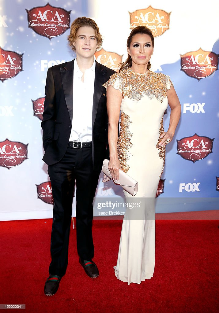 Gilligan Stillwater (R) and guest arrive at the American Country Awards 2013 at the Mandalay Bay Events Center on December 10, 2013 in Las Vegas, Nevada.