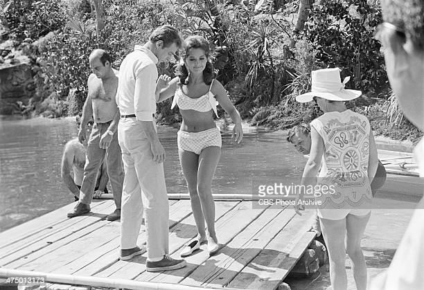 Gilligan's Island cast and crew set up in the lagoon at CBS Studio Center Russell Johnson and Dawn Wells stand in center of raft Image dated April 15...