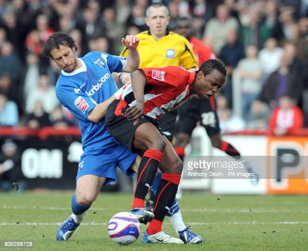 Gillingham's Adam Miller and Brentford's Marcus Bean battle for the ball during the CocaCola League Two match at Griffin Park Brentford