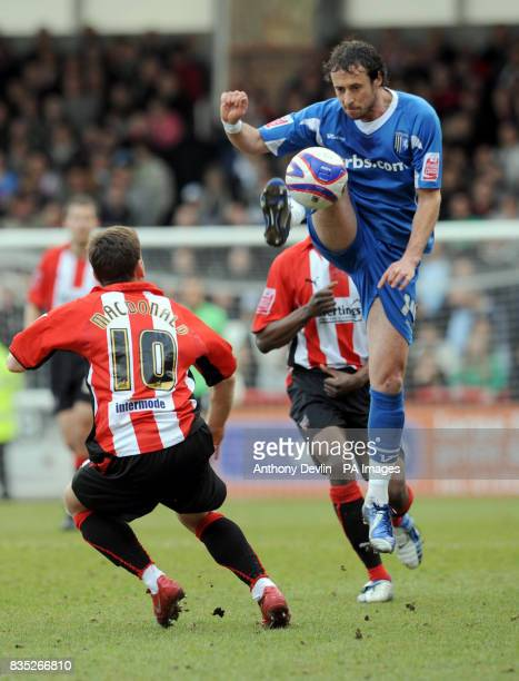 Gillingham's Adam Miller controls the ball during the CocaCola League Two match at Griffin Park Brentford