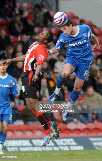 Gillingham's Adam Miller wins a header during the CocaCola League Two match at Griffin Park Brentford