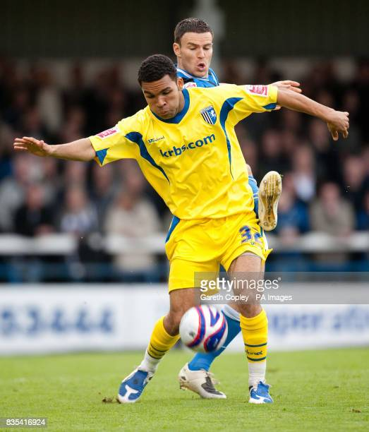 Gillingham's Andy Barcham holds off Rochdale's Simon Ramsden during the CocaCola League Two Play Off Semi Final First Leg match at Spotland Stadium...