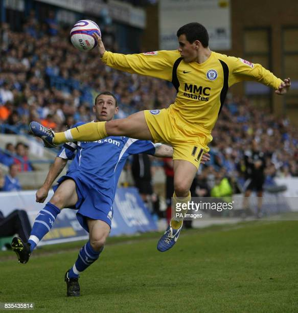Gillingham's Barry Fuller and Rochdale's Adam Rundle battle for the ball during the CocaCola Football League Two Play Off Semi Final Second Leg match...
