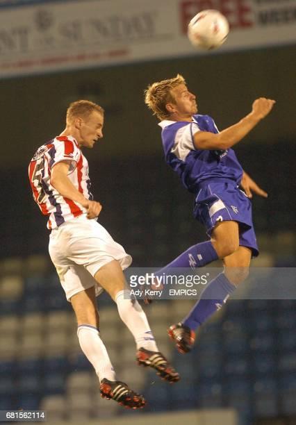 Gillingham's Danny Spiller and Willem II's Michel Kreek battle for the ball