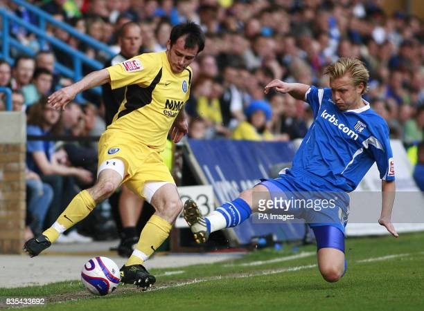 Gillingham's Josh Wright and Rochdale's Chris Dagnall in action during the CocaCola Football League Two Play Off Semi Final Second Leg match at the...
