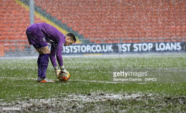 Gillingham's keeper Stuart Nelson places the ball during a hail storm in the game against Blackpool
