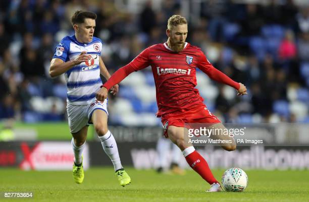 Gillingham's Scott Wagstaff gets a shot on gaol past Reading's Liam Kelly during the Carabao Cup first round match at the Madejski Stadium Reading