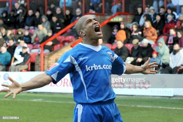 Gillingham's Simeon Jackson celebrates scoring a penalty during the CocaCola League Two match at Griffin Park Brentford