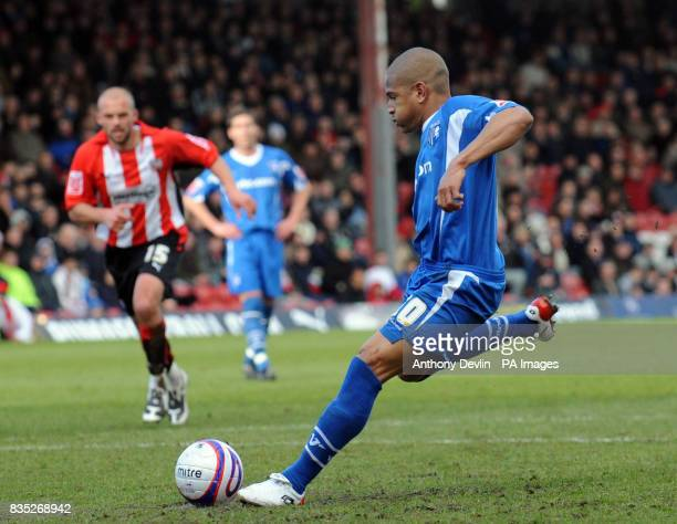 Gillingham's Simeon Jackson scores a penalty during the CocaCola League Two match at Griffin Park Brentford