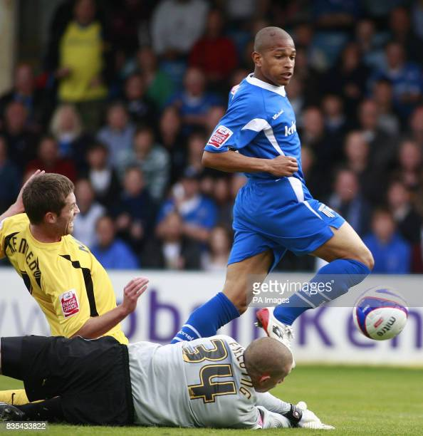 Gillingham's Simeon Jackson scores during the CocaCola Football League Two Play Off Semi Final Second Leg match at the KRBS Priestfield Stadium...
