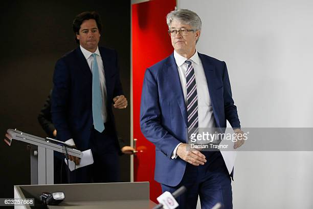 Gillon Mclachlan and AFL Chairman Mike Fitzpatrick walk in to the room to announce the 2012 Brownlow Medal will be awarded to Trent Cotchin of the...